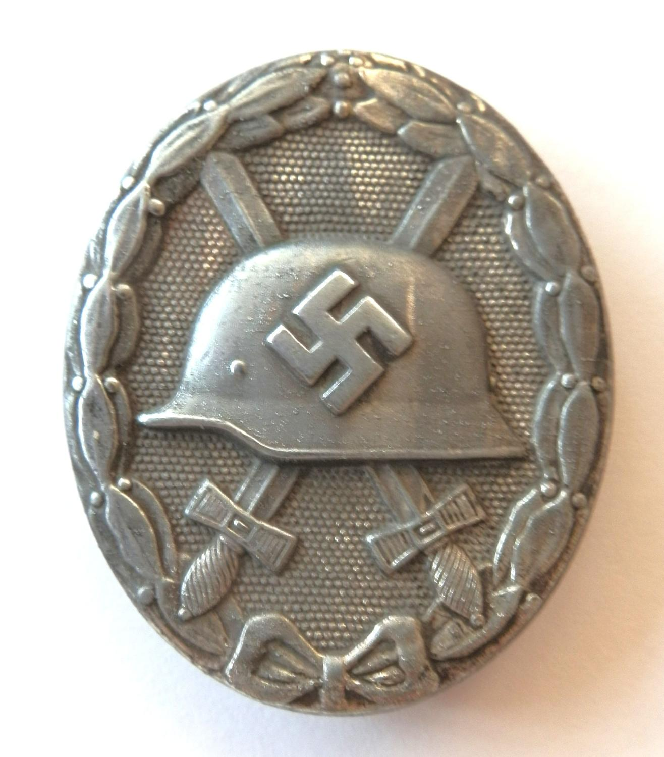 Silver Wound Badge. Marked L/21.