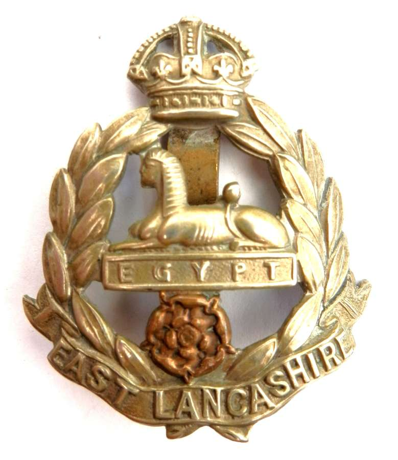 The East Lancashire Regiment Cap Badge.