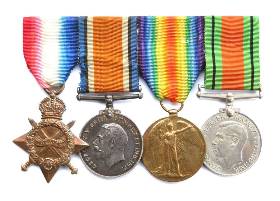 GROUP OF FOUR. Sjt George S. Evans. The Queen's Regiment.