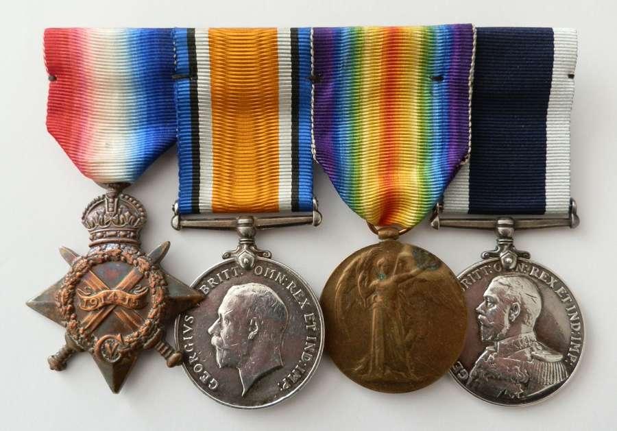 GROUP OF FOUR. Reginald Kidston Ordnance Artificer. Royal Navy.