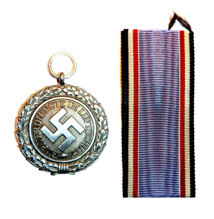 German Air Raid Warden 2nd Level Medal.